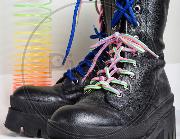 youth boots with colorful laces and teenage accessories
