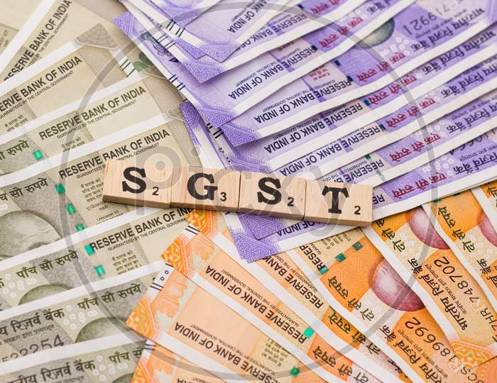 Assam, india - March 30, 2021 : Word GST written on wooden cubes stock image.