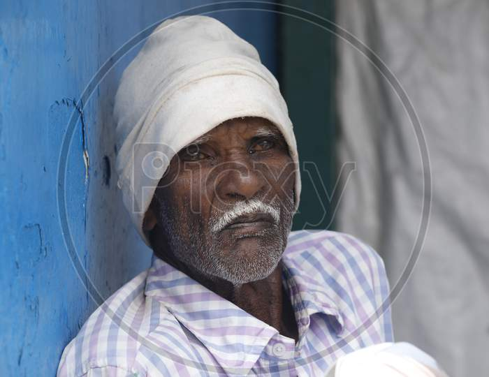 Indian Old man at rural home