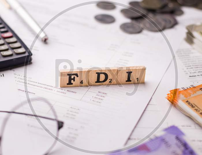 Assam, india - March 30, 2021 : Word FDI written on wooden cubes stock image.