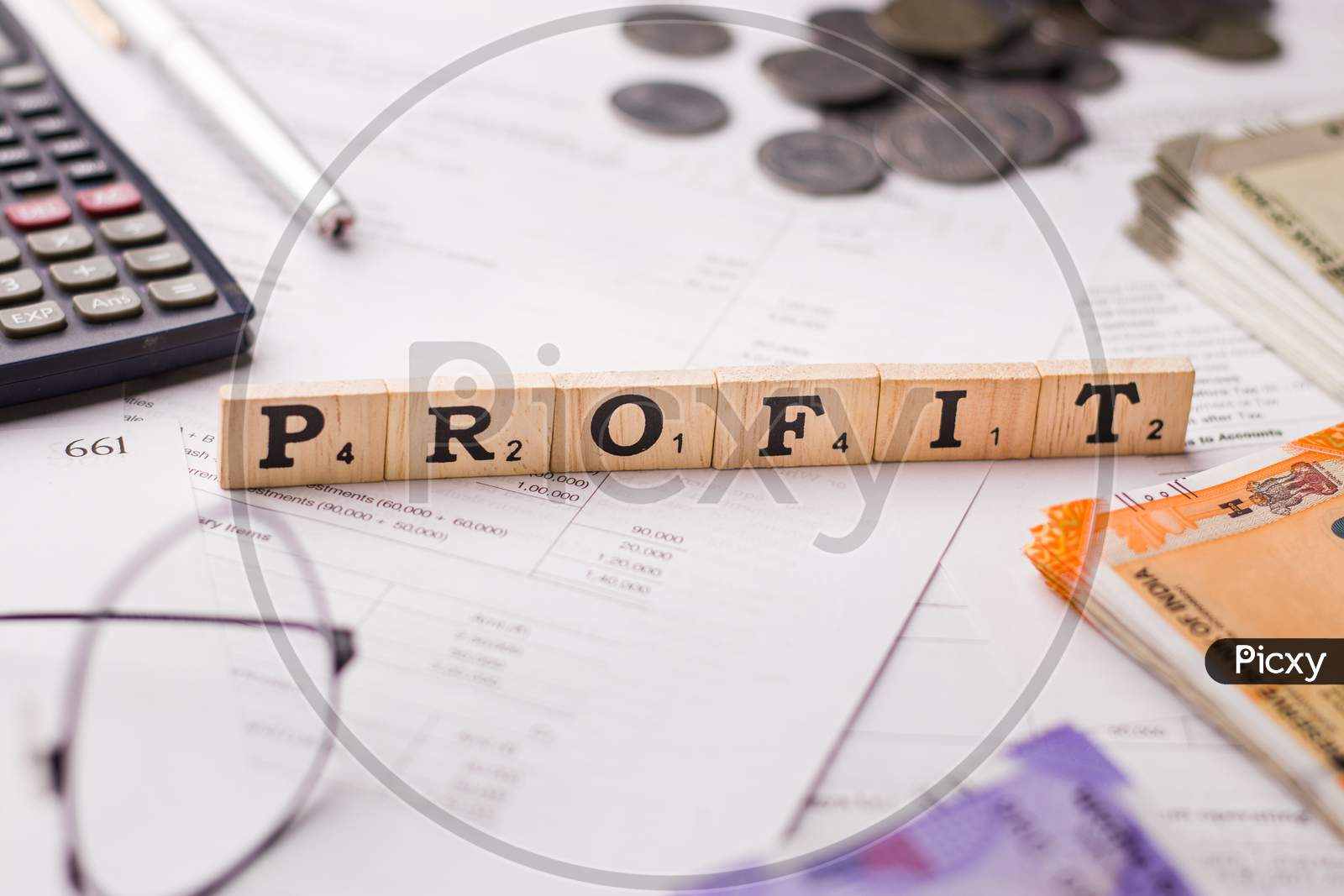 Assam, india - March 30, 2021 : Word PROFIT written on wooden cubes stock image.