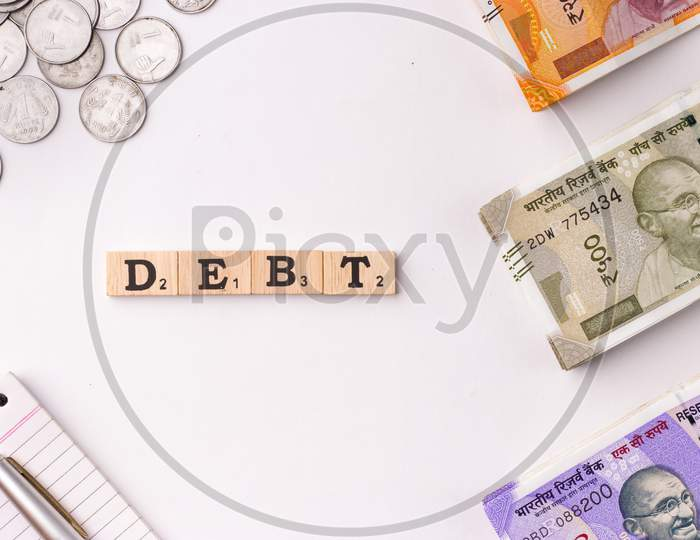 Assam, india - March 30, 2021 : Word DEBT written on wooden cubes stock image.