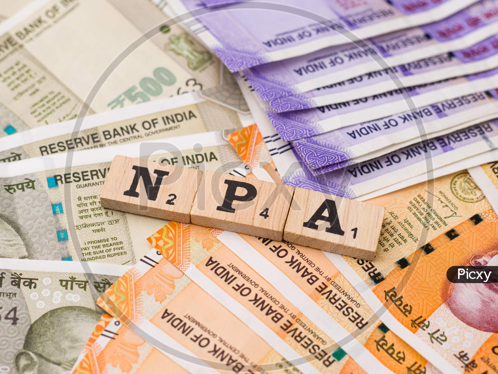 Assam, india - March 30, 2021 : Word NPA written on wooden cubes stock image.