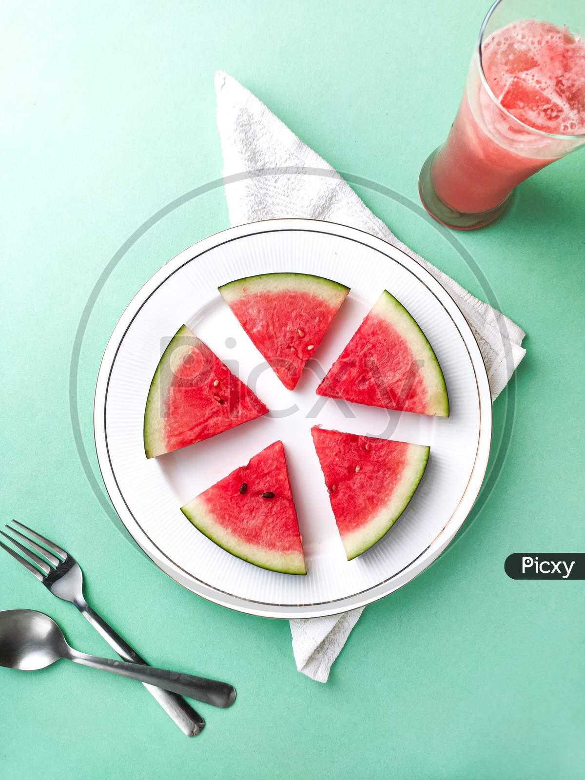 Creative sliced watermelon stock image.