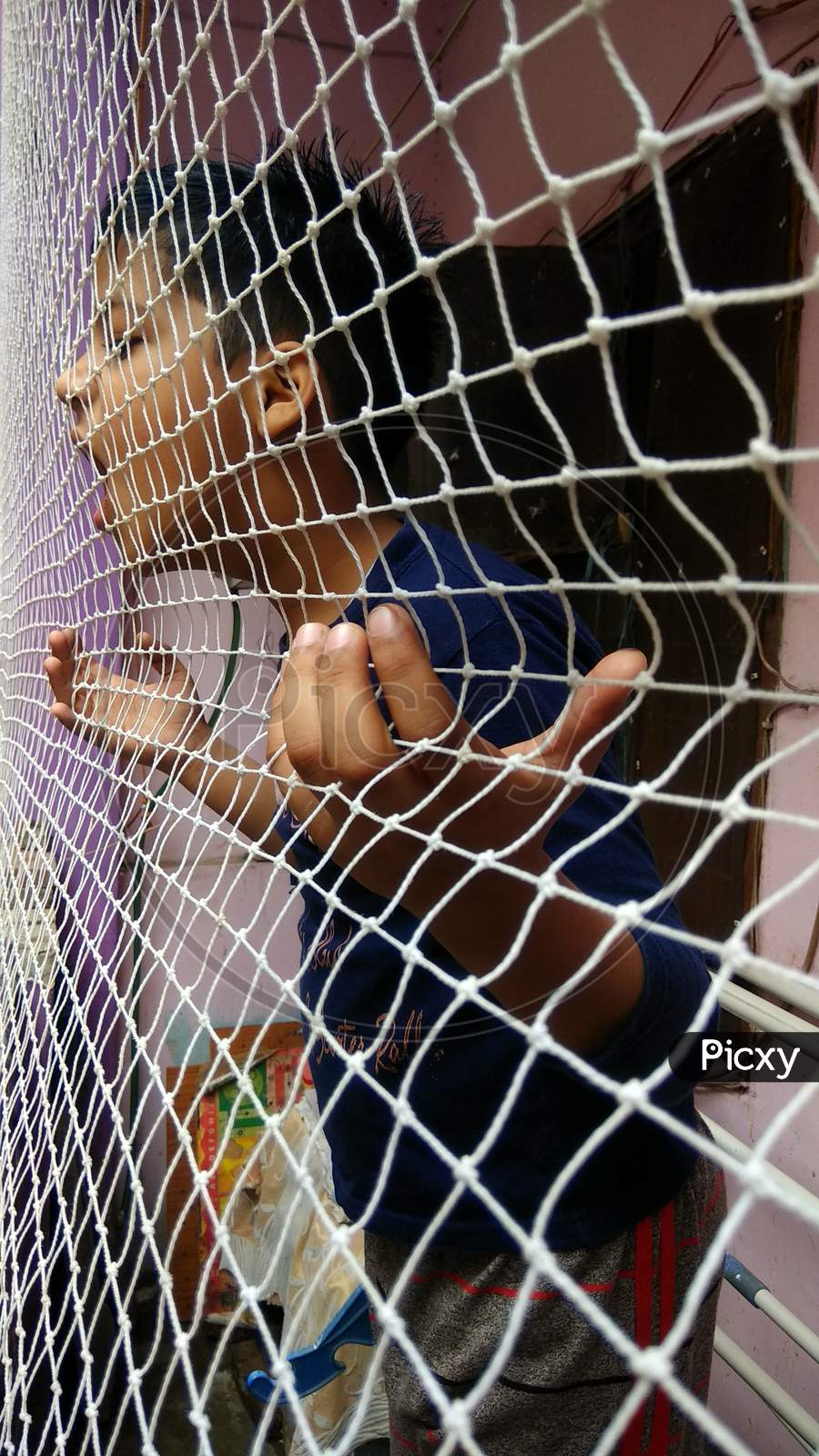 Child or Kid in cage or Home arrest concept