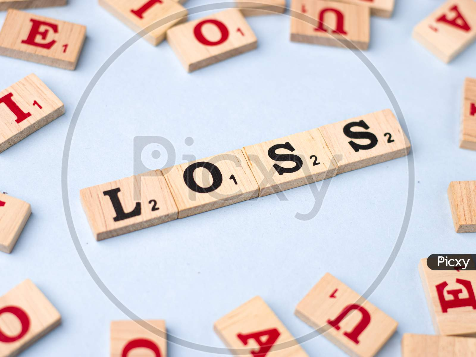 Assam, india - March 30, 2021 : Word LOSS written on wooden cubes stock image.
