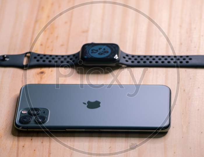 Galle, Sri Lanka - 02 19 2021: Apple Iphone 11 Pro Max And Apple Watch Series 6 Lay Flat On A Wooden Table, Luxury And Lifestyle Concept.