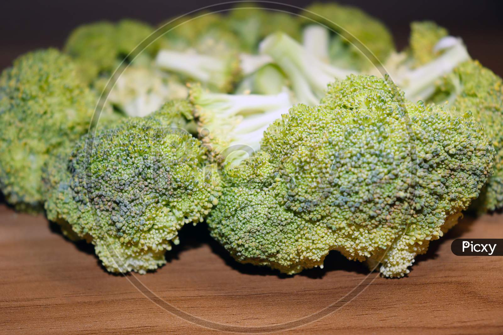 Sliced Broccoli Stock On Wooden Table
