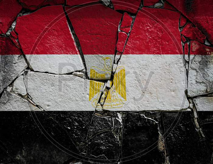 National Flag Of Egypt  Depicting In Paint Colors On An Old Stone Wall. Flag  Banner On Broken  Wall Background.