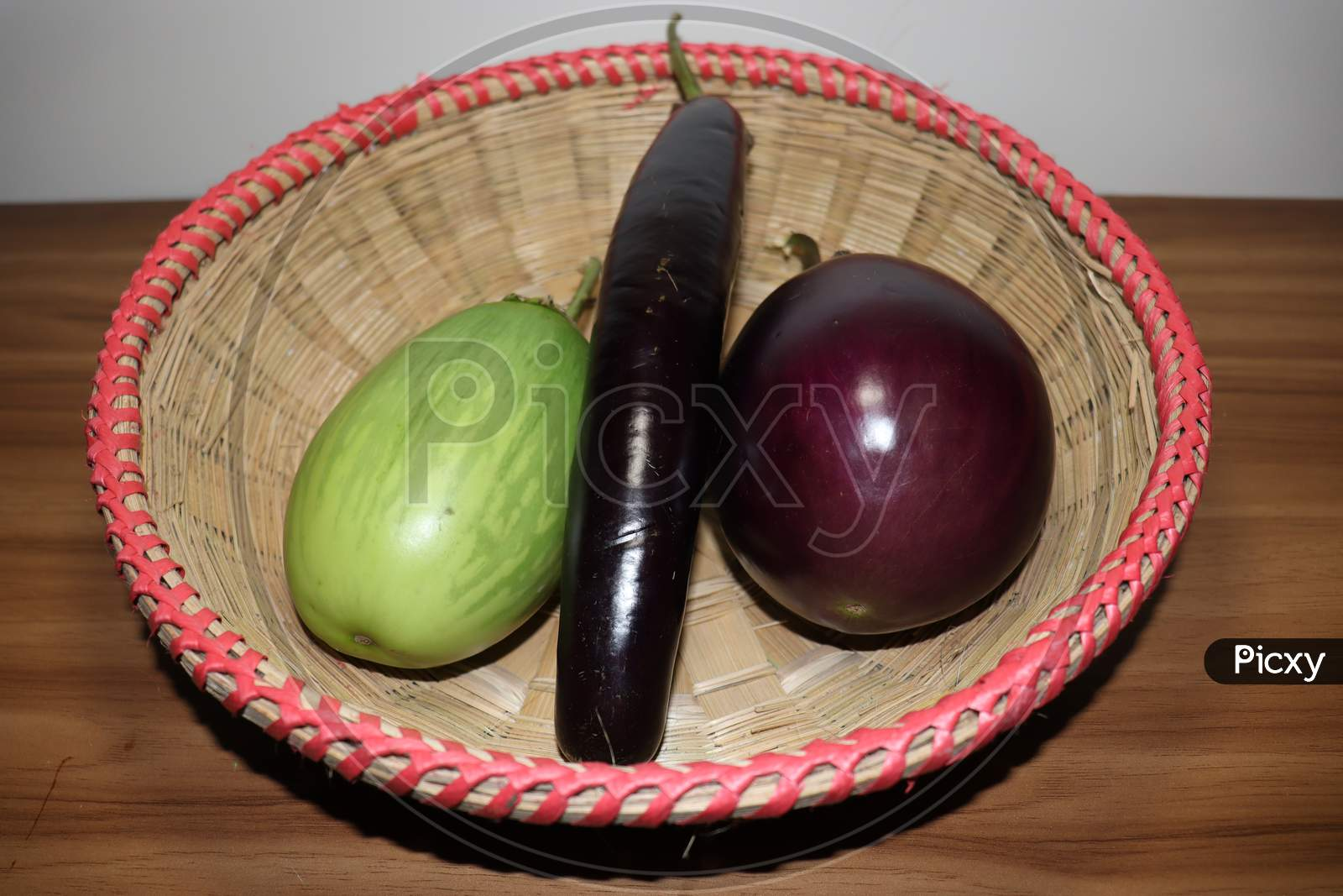Tasty And Healthy Violet And Green Colored Brinjal