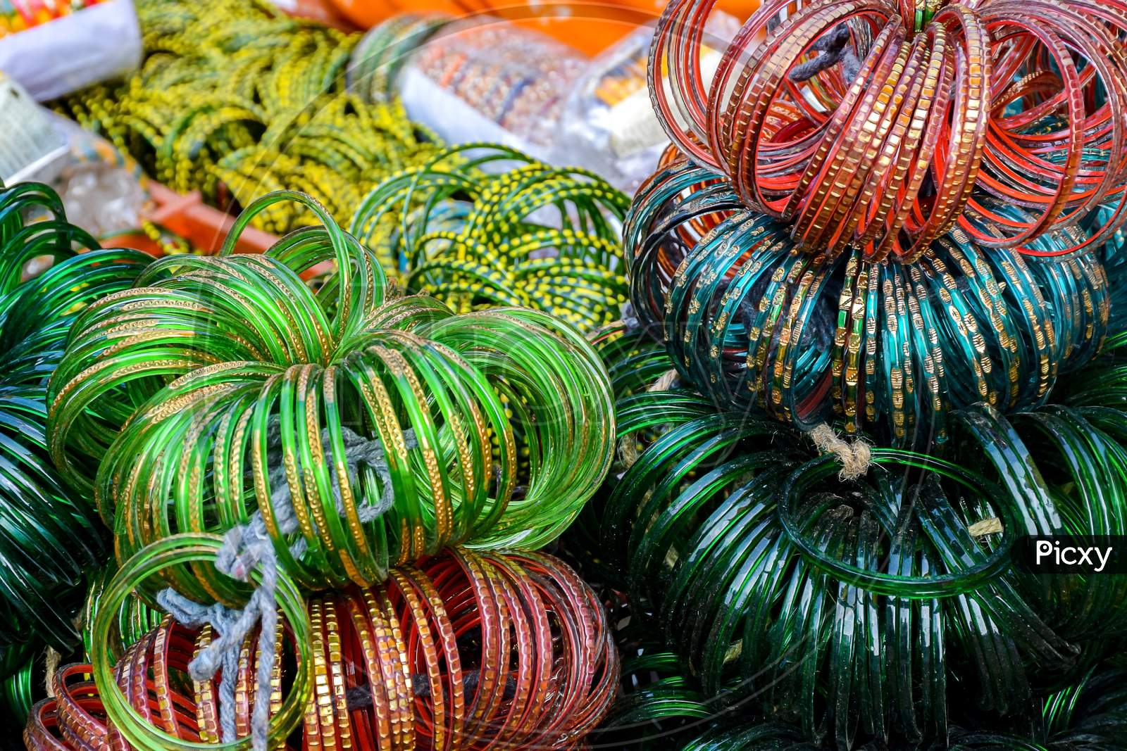 Stock Photo Of Bunch Of Colorful Bangles Made Of Glass Kept On Roadside For Sale In Sunny Afternoon At Indian Market ,Focus On Glass Bangles.