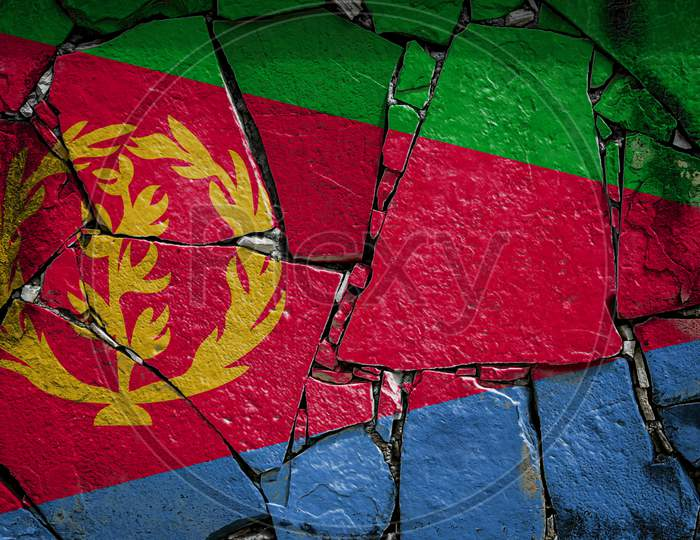 National Flag Of Eritrea  Depicting In Paint Colors On An Old Stone Wall. Flag  Banner On Broken  Wall Background.