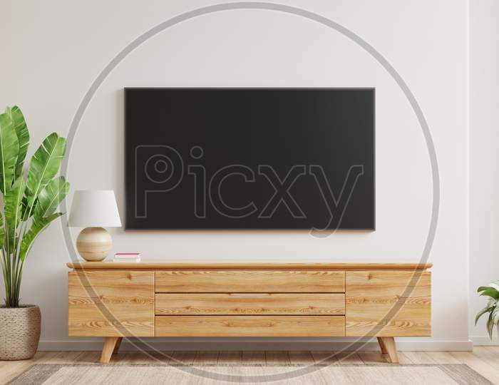 Mockup A Tv Wall Mounted In A Living Room Room With A White Wall.