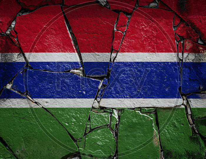 National Flag Of Gambia  Depicting In Paint Colors On An Old Stone Wall. Flag  Banner On Broken  Wall Background.