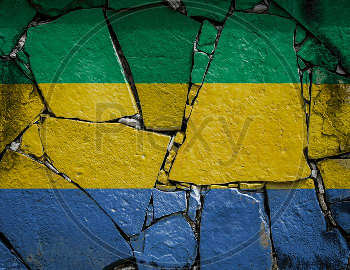 National Flag Of Gabon  Depicting In Paint Colors On An Old Stone Wall. Flag  Banner On Broken  Wall Background.