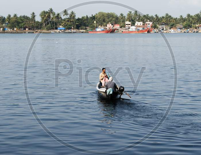 """""""Mangalore, Karnataka, India - April 2Nd 2021 : Indian Fishermen With Their Boat On The River Ready For Fishing"""""""