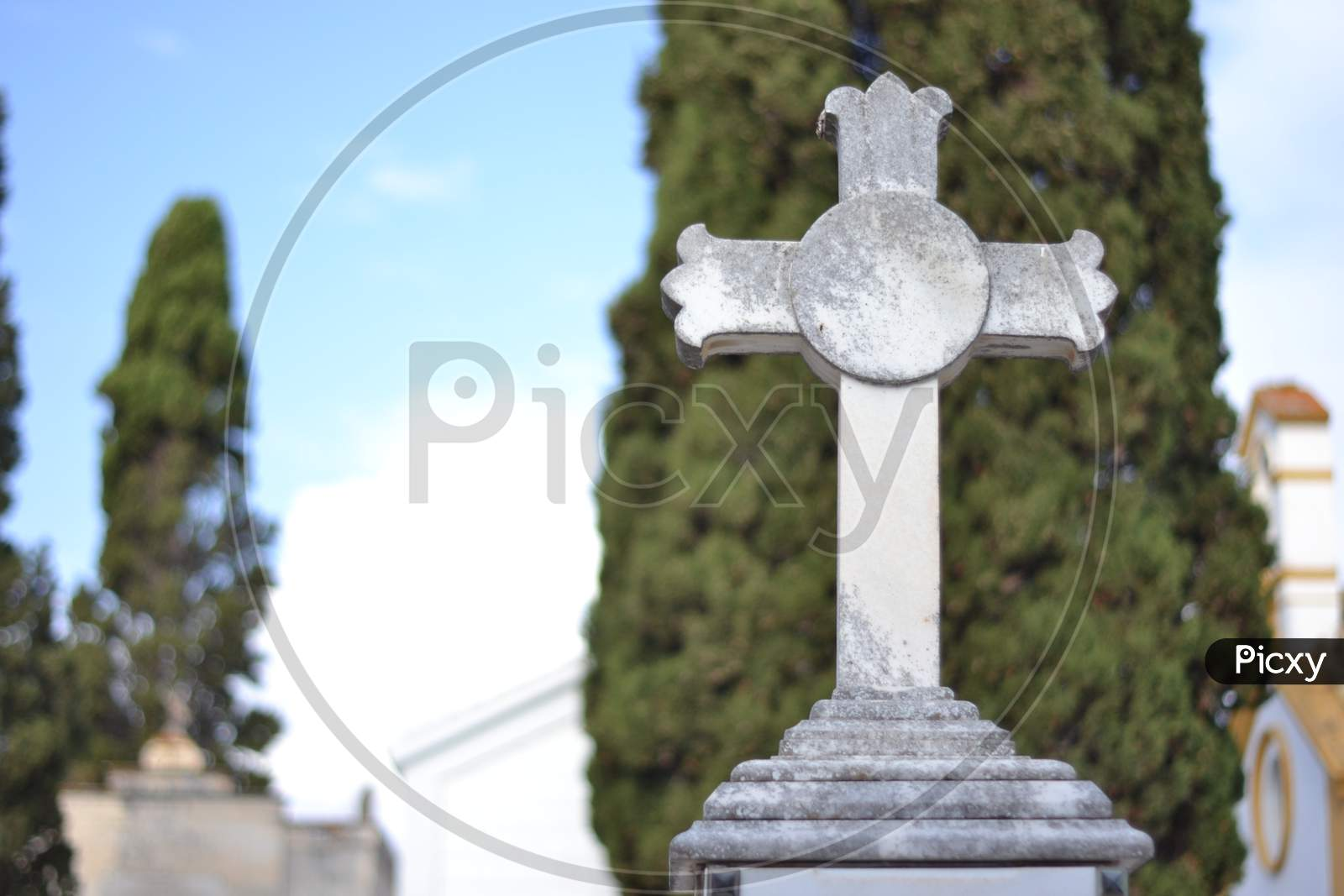 White Marble Cross In A Cemetery
