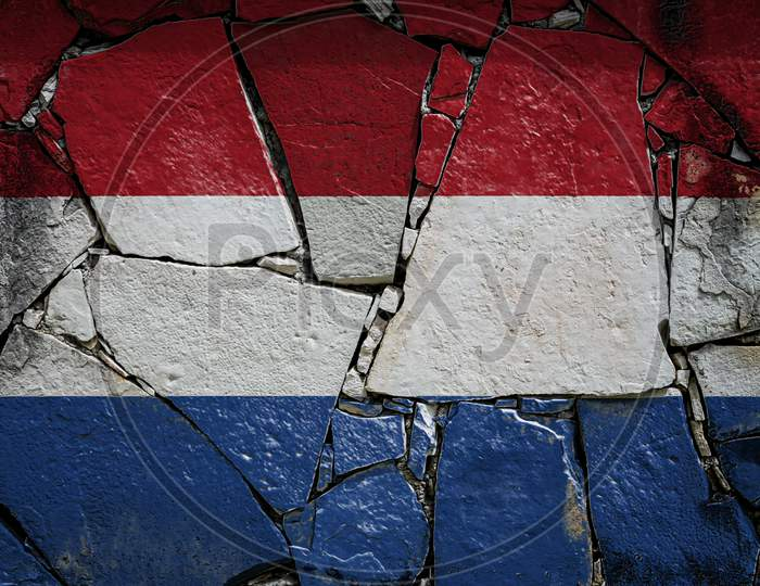 National Flag Of Netherlands Depicting In Paint Colors On An Old Stone Wall. Flag  Banner On Broken  Wall Background.