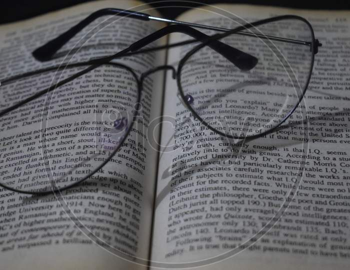 glasses with book in background