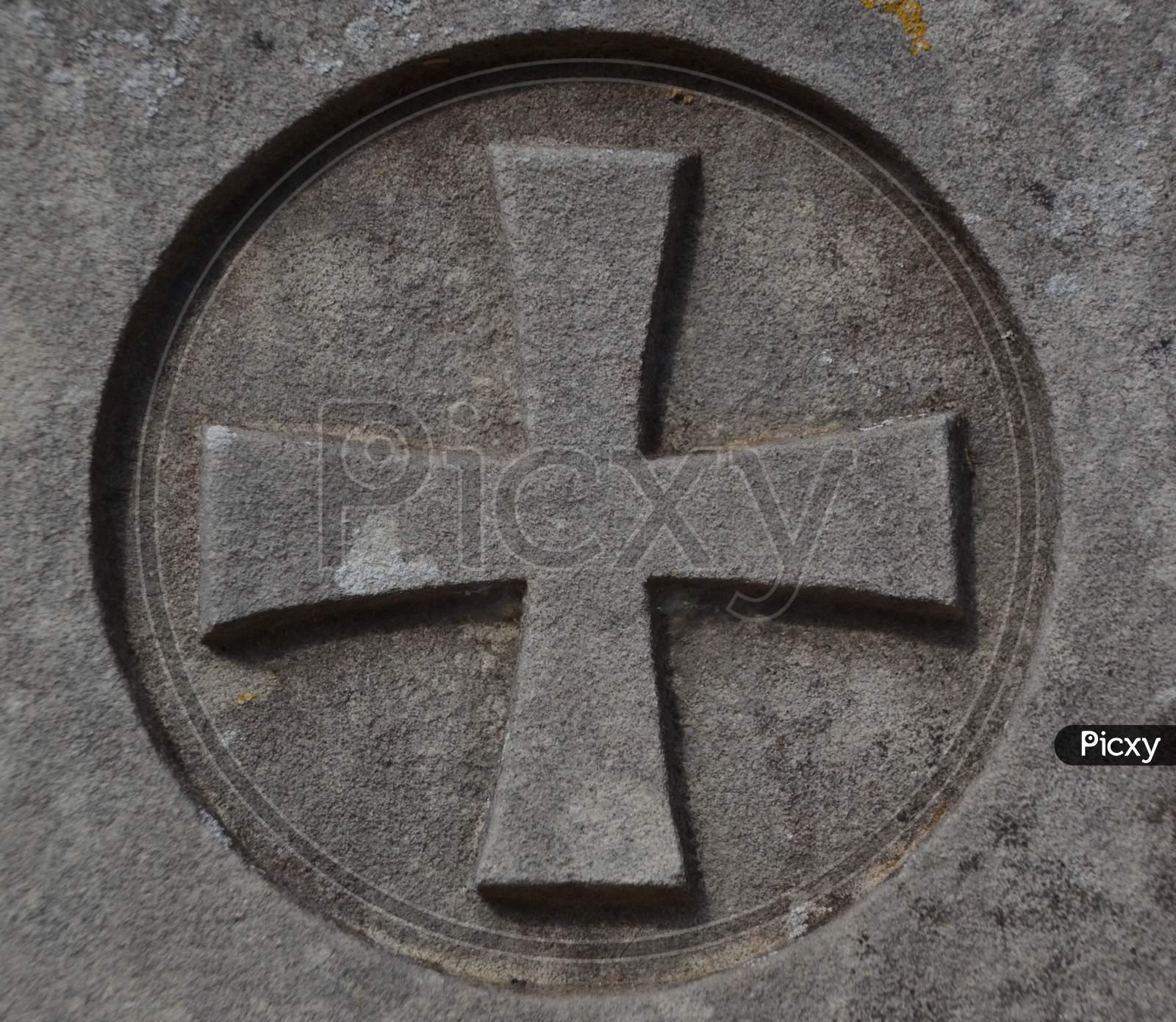 Maltese Cross In A Cemetery