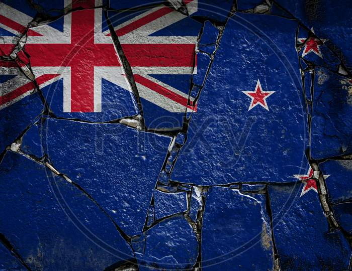 National Flag Of New Zealand Depicting In Paint Colors On An Old Stone Wall. Flag  Banner On Broken  Wall Background.