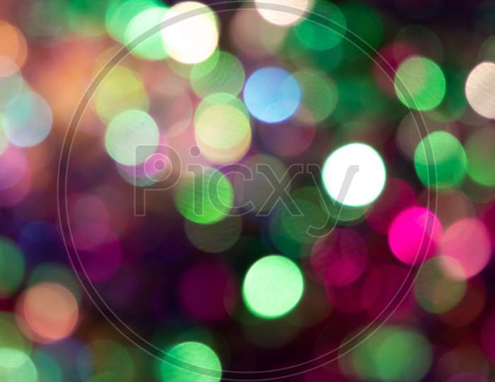 Festive colorful bokeh background with psychedelic colorful sparkles and colorful dots as perfect background for silvester, celebration and happy new year annotations as beautiful blurred glow