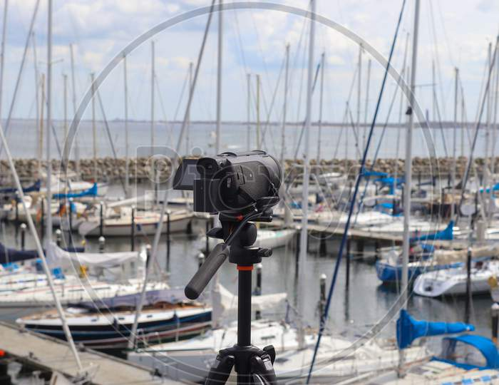 Selective Focus View At A Camera Filming At A Yacht Port In Kiel In Germany