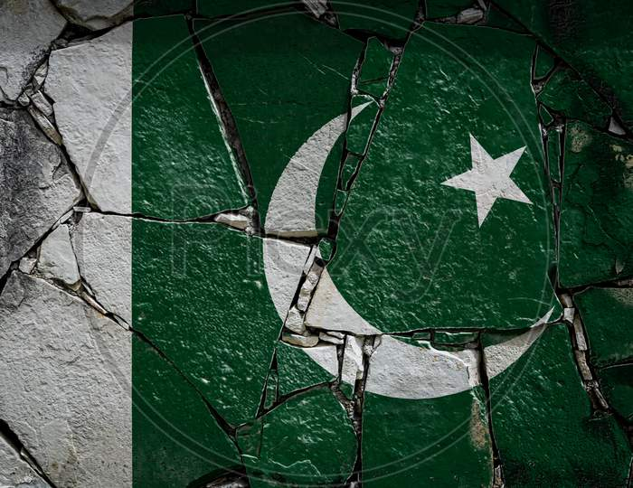 National Flag Of Pakistan  Depicting In Paint Colors On An Old Stone Wall. Flag  Banner On Broken  Wall Background.