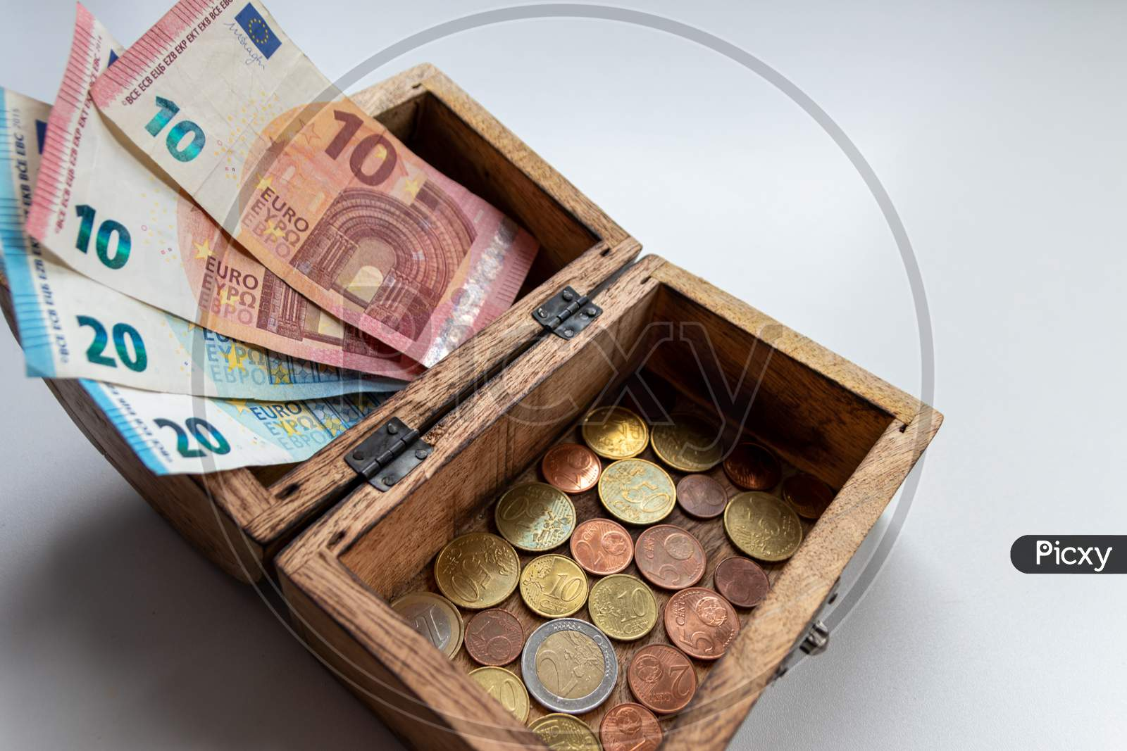 Bunch of european money with coins and bank notes show international finance with euro and europe, financial trade with a 2 euro coin and different euro coins and euro bank notes for financial success