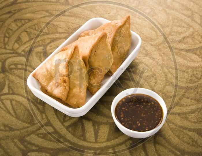 Indian Snacks Samosa With Chutney