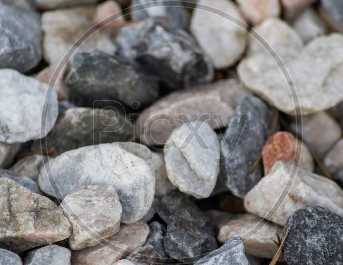 Raw rocks and minerals as natural stones background with crushed and rough material at a nice coast or rocky beach show nuggets and sandstones