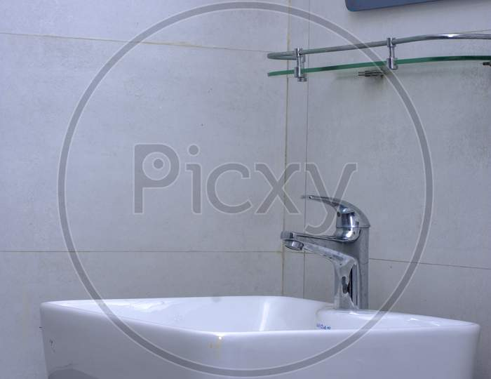 A Very Stylish Squire Wash Basin With A Tap.