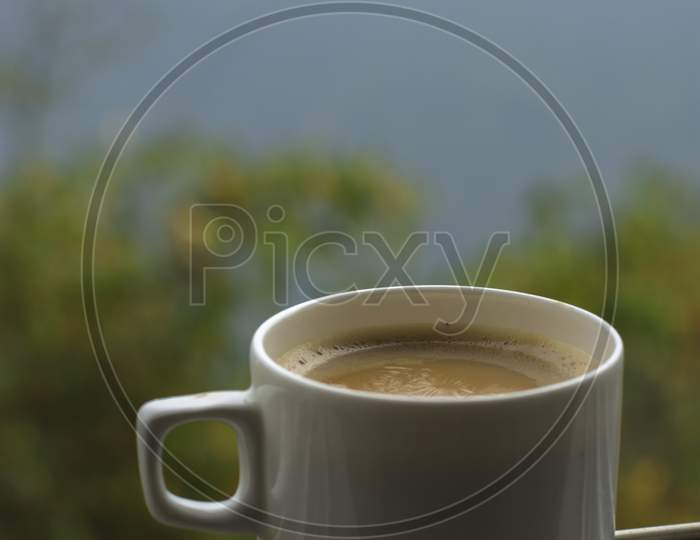 A Cup Of Tea With The View Of Gangtok City. Selective Focus.