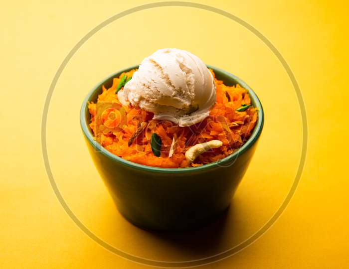 Galar Halwa With Vanilla Ice Cream, Served In A Bowl And Garnished With Dry Fruits. Selective Focus