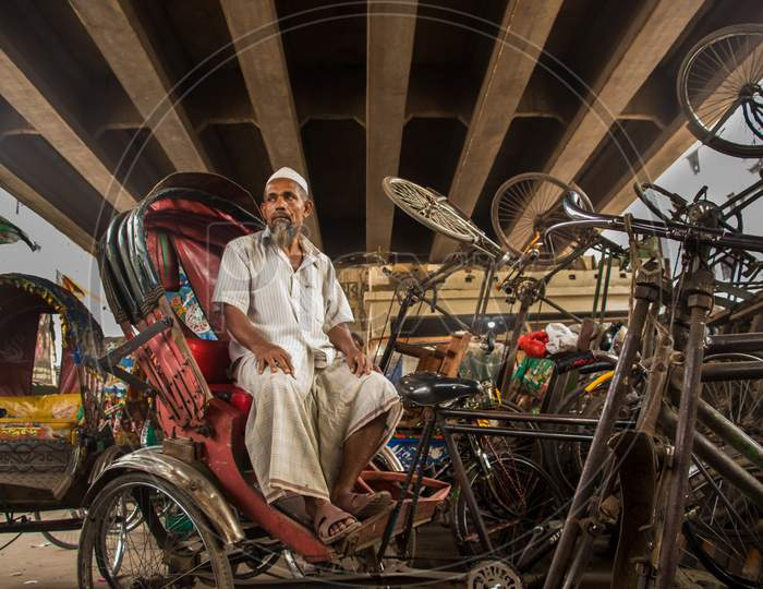 Rickshaw Puller Taking Rest. This Image Was Captured  On March-30-2021, From Dhaka, Bangladesh, South Asia
