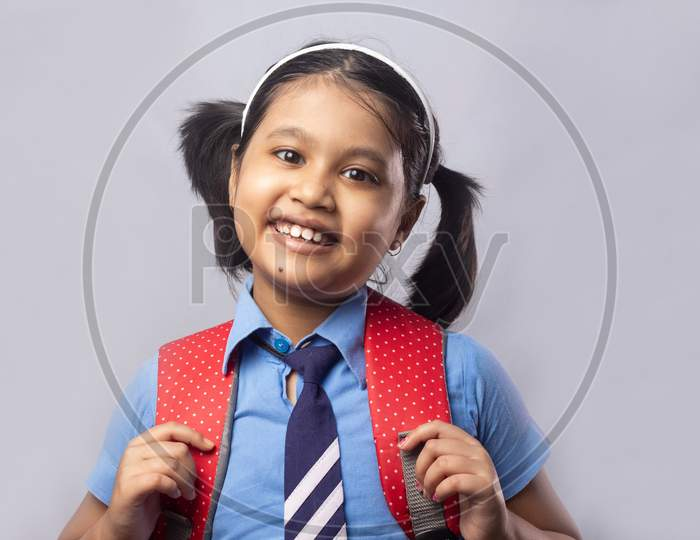 Smiling Girl Child In School Uniform